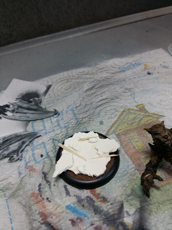 1 begin building base with sculpey and sticks